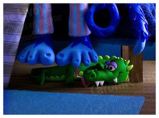 > Caché sous le lit...